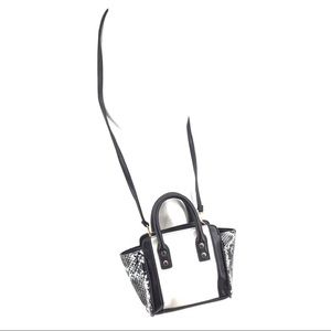 Avon Bags - Avon snakeskin and white black trim purse